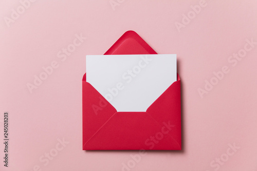 Photo Blank white card with red paper envelope template mock up