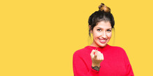 Young Beautiful Woman Wearing Red Sweater And Bun Beckoning Come Here Gesture With Hand Inviting Happy And Smiling