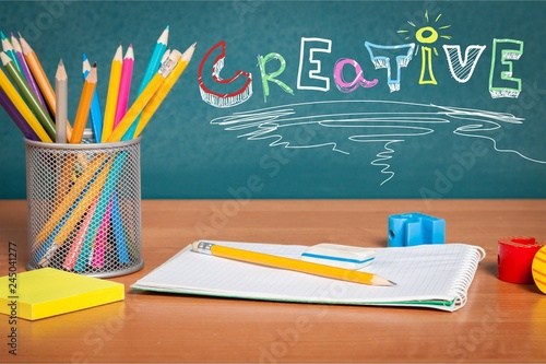 Fototapety, obrazy: Colorful school supplies on blackboard background