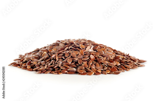 flax seeds in a pile isolated on white background