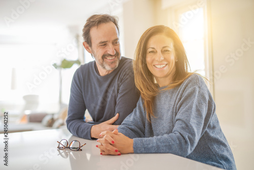 Fotografia  Romantic middle age couple sitting together at home