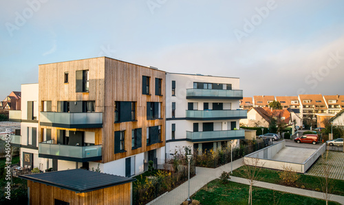 Fotografiet  Modern townhouses in a residential area with multiple new apartments buildings s