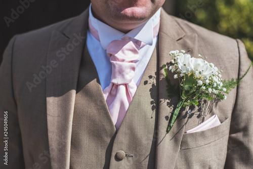 Tableau sur Toile groom displaying his suit and corsage