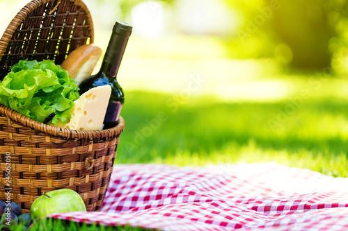 Picnic basket in summer park