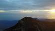 People on the peak of volcano enjoying the sunrise. 4k aerial footage captured on Mt Rinjani in Indonesia.