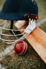 Cricket Equipments On Green Gr...
