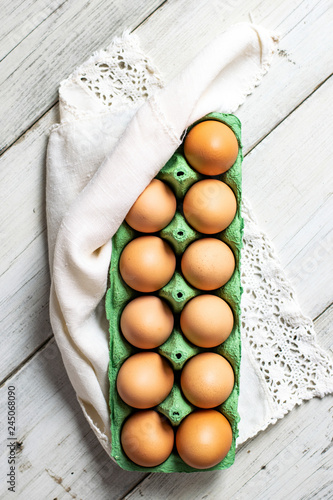 Chicken eggs in a green tray