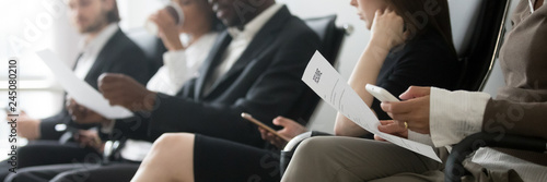 Horizontal side photo multinational applicants businesspeople sitting in queue w Canvas Print