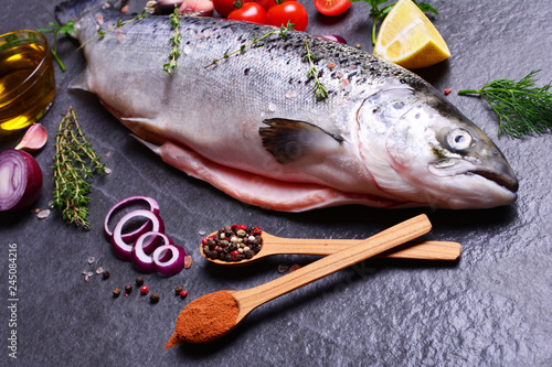 Fish salmon with spices and vegetables
