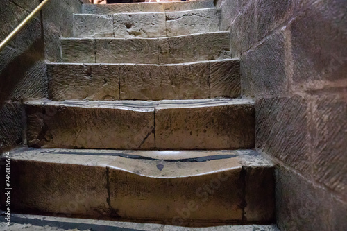 Tablou Canvas Jerusalem \ Israel - Octobe 14 2018: Heavily worn steps of a stairs in Church o a Holy Sepulchre