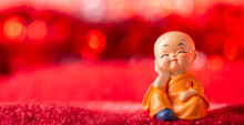 Decorative Baby Monk On Bokeh Background , Far East Concept