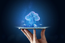 Creative Background, Male Hand With The Phone, The Image Of The Hologram Of The Cloud, Blue Background. The Concept Of Cloud Technology, Cloud Storage, A New Generation Of Networks. Mixed Media.