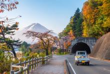 Mount Fuji On Lake With Autumn Garden On Tunnel In Kawaguchiko Lake