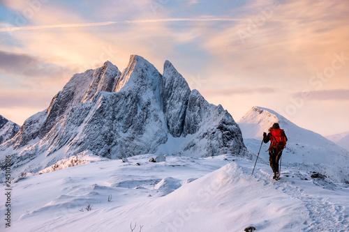 Vászonkép Mountaineer man climbs on top snowy mountain