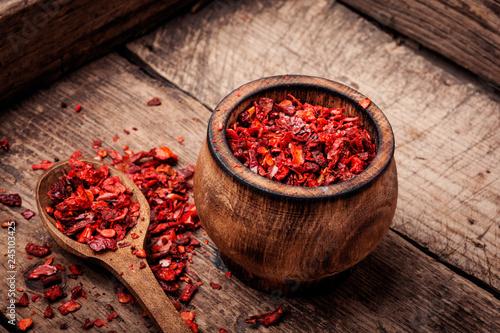 Tuinposter Kruiderij Seasoning pepper sweet, red, sliced.