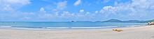 Panorama Of Colourful Kayak, Beach, Sea With Wave, Mountain, Blue Sky