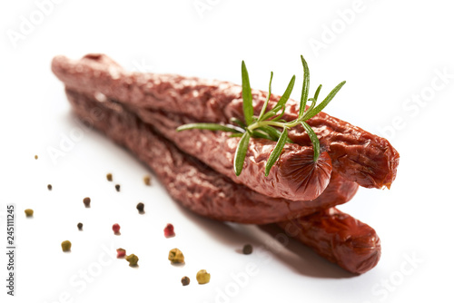 Obraz Sausage with herbs and spices on a white background - fototapety do salonu