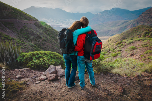 Foto op Aluminium Ontspanning happy loving couple hiking travel in mountains