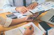 Leinwanddruck Bild - Business advisor analyzing financial figures denoting the progress Internal Revenue Service checking document. Audit concept