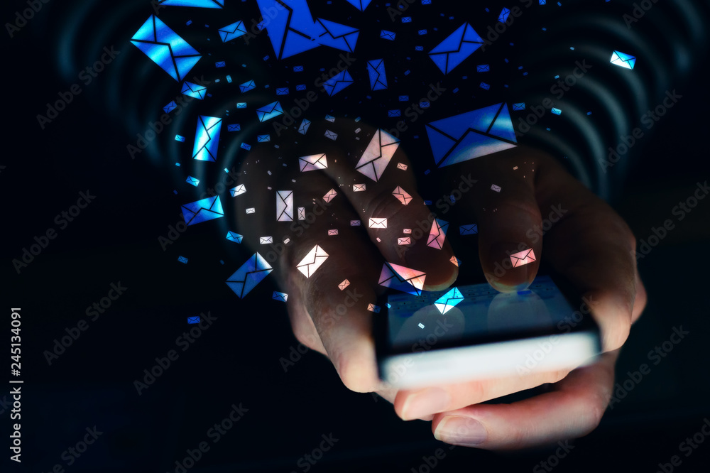 Fototapety, obrazy: Woman using mobile phone for text messaging in dark