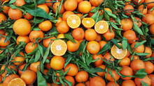 Orange Fruit With Leaves For Sale On Market