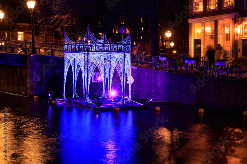 Luminous arbor on the water of the canal of Amsterdam