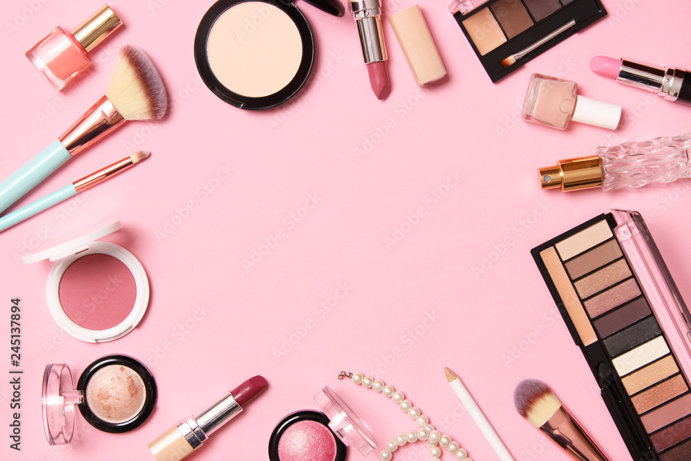 Fototapety, obrazy:  professional makeup tools. Makeup products on a colored background top view. A set of various products for makeup.
