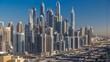Dubai Marina skyscrapers aerial top view at sunrise from JLT in Dubai timelapse, UAE.