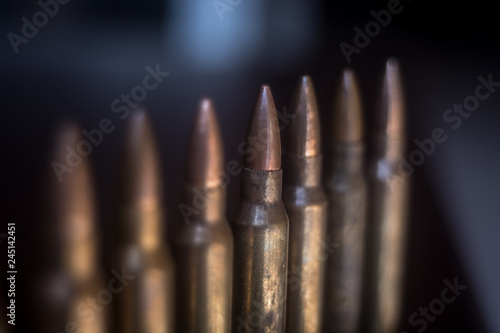 Stampa su Tela bullets on black background