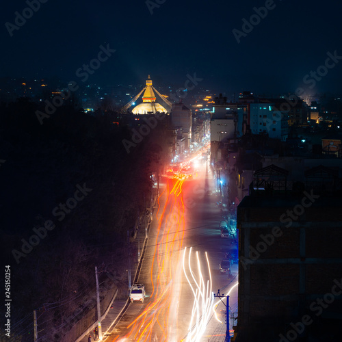 Boudhanath stupa and Boudha Road at night in Nepal.