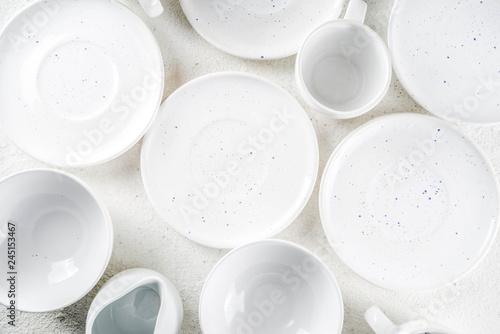 Fotografie, Obraz  Assortment stack clean empty new white kitchen utensils, plates, bowls, cups mugs
