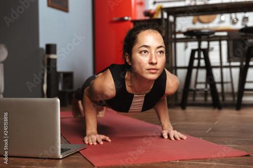 Beautiful healthy woman doing yoga exercises Obraz na płótnie