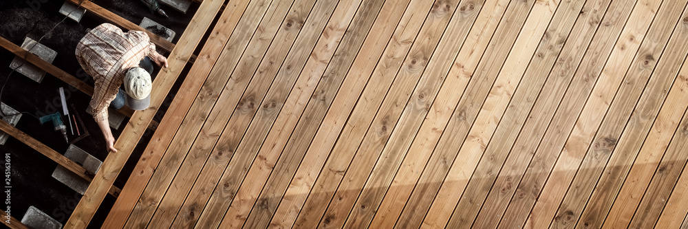 Fototapety, obrazy: Constructing the wooden flooring of a patio xxl:xmstore
