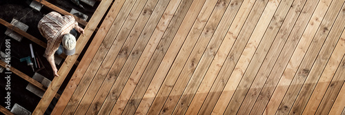 Constructing the wooden flooring of a patio Fototapet