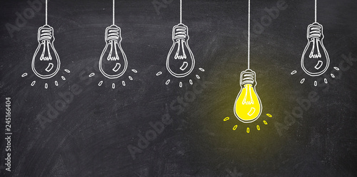 Photo  five bulb on blackboard one bulb bright yellow. ideo concept