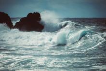 Waves Crash Along The Black La...
