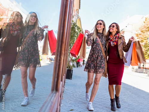 obraz PCV Smiling shopping girl with bags in the city - spring sales