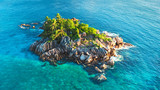 Tropical island with sea and palm taken from drone. Seychelles aerial photo. St Pierre Island