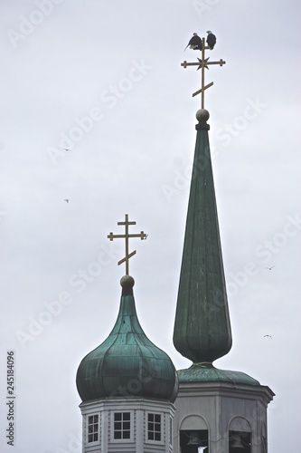 Fotografie, Obraz  Sitka, Alaska, USA: Two bald eagles (Haliaeetus leucocephalus) perched on the top of the spire of St