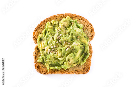 Toasted breads with avocado and sesame seeds isolated on white background. Top view