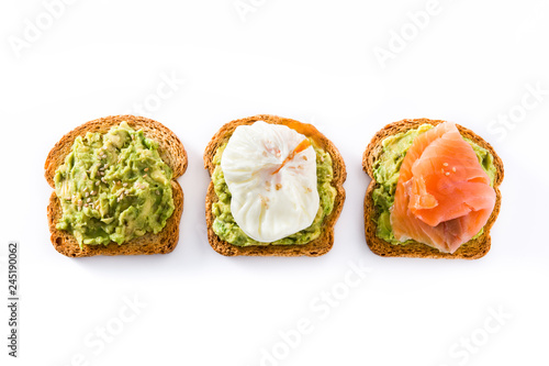 Fényképezés Toasted breads with avocado, poached eggs and salmon isolated on white background