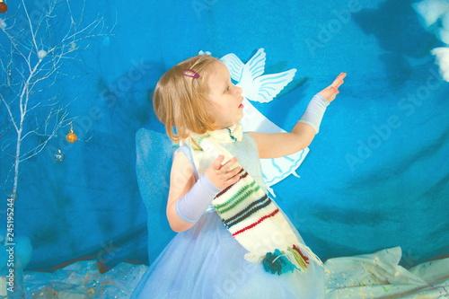 Fotografie, Obraz  little girl in snow-white costume poses for the camera