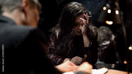 Fotografie, Obraz  Desperate lady crying after finding out about husbands murder, writing testimony