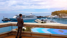 Serious Businessman Talking On Phone, Enjoying View Of New Yacht, Private Harbor