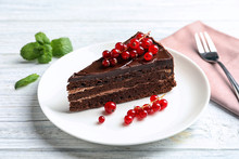 Plate With Slice Of Chocolate Cake And Berries On Table