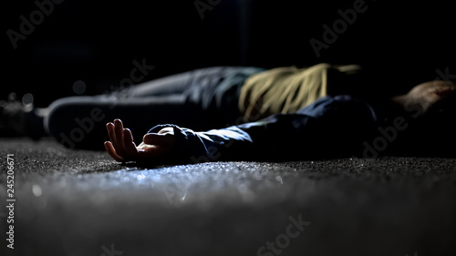 Fototapeta Body of woman lying on ground, contract killing, revenge or robbery, horror