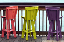 Colorful Wooden Bar Stools At A Waterfront Cafe In Key West,Florida