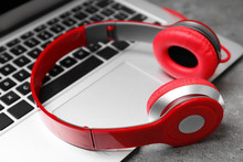 Modern Headphones And Laptop On Table, Closeup