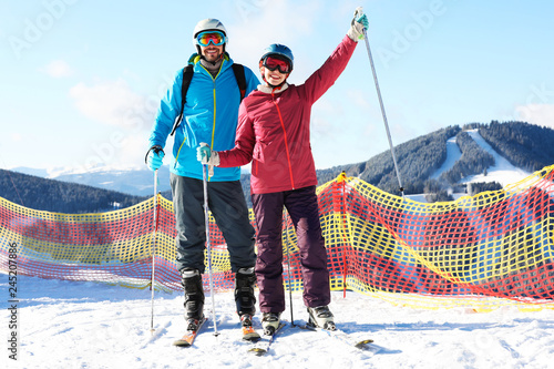 Garden Poster Winter sports Couple spending winter vacation at mountain ski resort