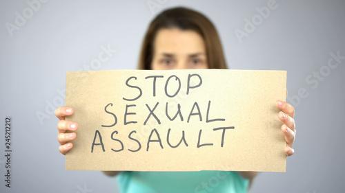 Billede på lærred Stop sexual assault sign in womans hands, female rights protection, awareness